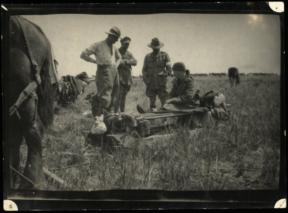 Members of the Wellington Mounted Rifles and a makeshift stretcher in Palestine, 1918.