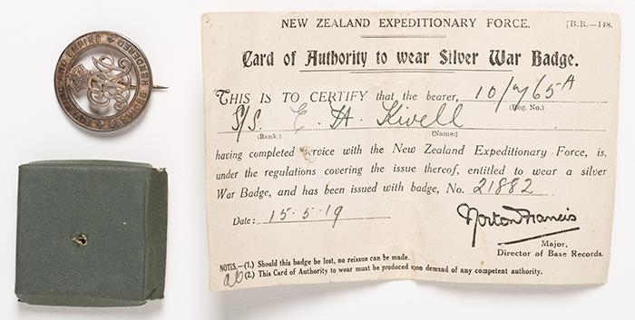 Men wearing war badges or armbands had to also carry a card of authority.