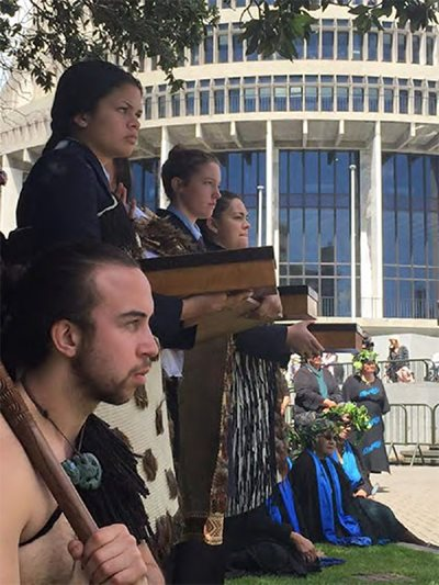 Students Tai Te Ariki Jones, Leah Bell and Rhiannon Magee present the petiiton on Parliament grounds.
