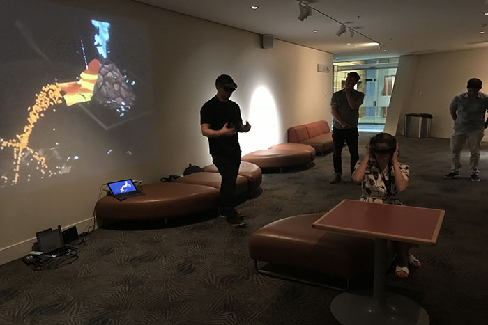 A demonstration of the HoloLens technology to Auckland Museum staff.