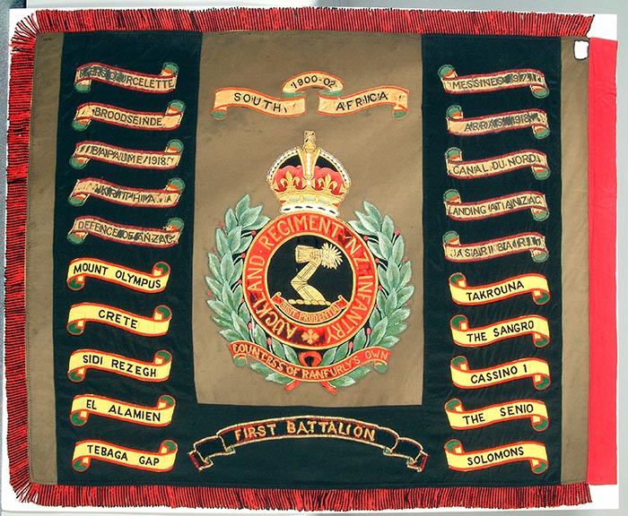 Regimental Colours: 3rd Auckland (Countess of Ranfurly\u0027s Own) Regiment, bearing Battle Honours for the Anglo-Boer, First and Second World Wars. Presented in approximately 1929 and laid up at Museum, circa 1973.