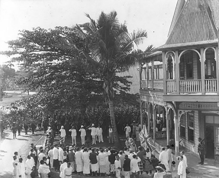 The Court House and the raising of the Union Jack, Apia. 30 August 1914.