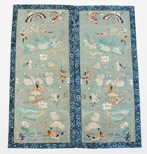 A double textile panel displaying birds