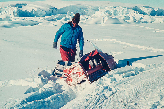 Unknown photographer (ca. 1957) Edmund Hillary with crashed sledge, Antarctica