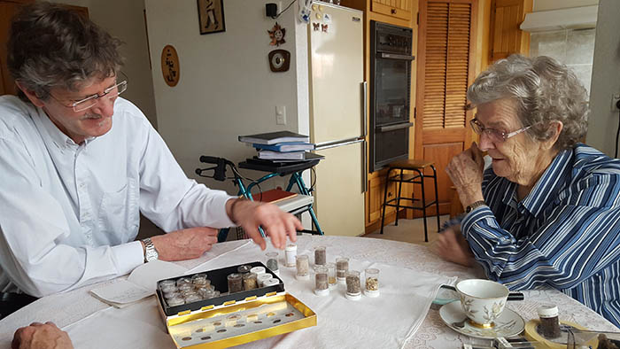 Hugh Grenfell and Tonny Brinkman with a chocolate box of sands at Tonny\u0027s home in Henderson