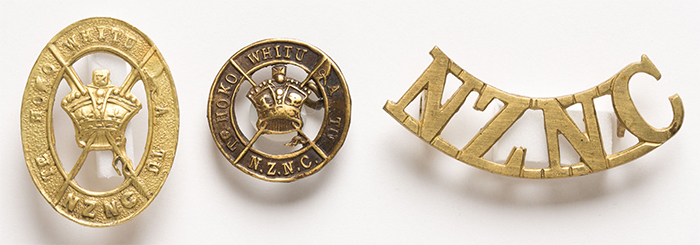 The Native Contingent hat and collar badges and shoulder title.