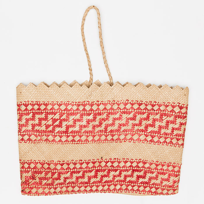 This kete tataī rua is made from pandanus, red dye and swamp taro plant fibre.