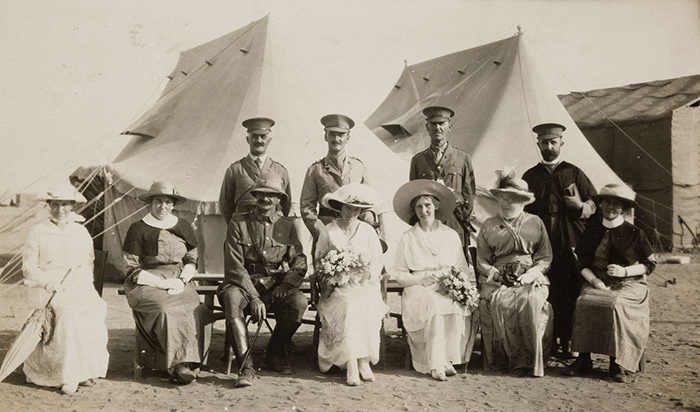 A formal photograph of Captain Thomas Arnold Blake and Miss Mabel Constance Deane\u0027s wedding party.